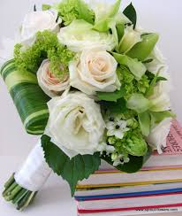Cream and Green Flowers For both a Bride and can be made smaller for your girls..prices vary due to size.