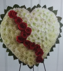 crossed shaped heart in white funeral flowers