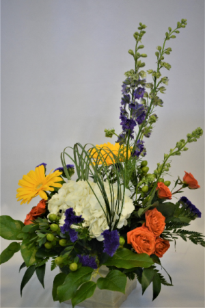 WITH THE GLOW OF RADIANCE FRESH FLOWER ARRANGEMENT