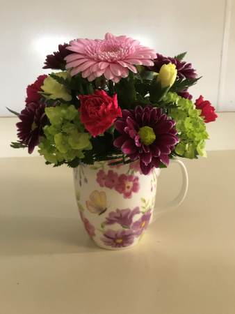 Cup of Spring Beauty  Fresh Arrangement