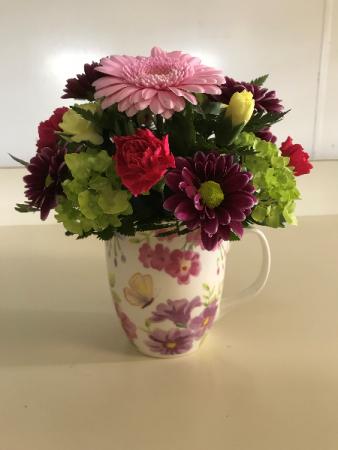 Cup of Spring Beauty  Fresh Arrangement