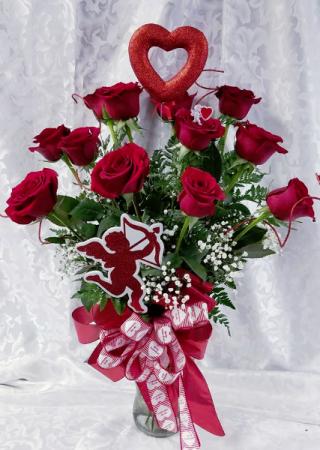Cupids Vase Dozen Roses In A Vase In Fulton Ny Devine Designs