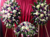 CUSTOM 3 PC PURPLE AND PINKS FUNERAL PACKAGE 2-STANDING SPRAYS AND CASKET PIECE