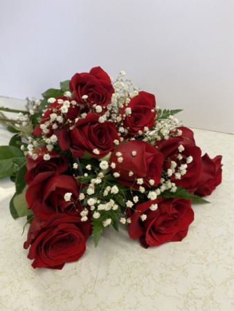 cut red roses and baby breath cut bouquet
