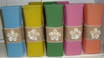 Cute colored vase we fill with bright seasonal flowers. Just choose a price!
