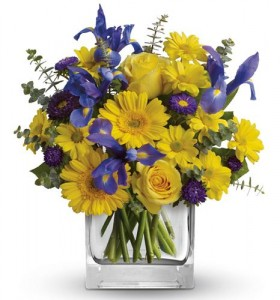 BLUE IRIS AND YELLOW ROSES AND OTHER YELLOWS   ARRANGED IN A RECTANGULAR VASE!!