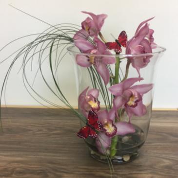 Cymbidium orchid vase arrangement Orchid arrangement