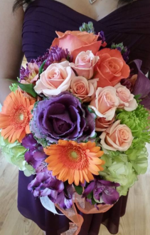 Dark purples with creamy oranges touch of green Handtied Bouquet