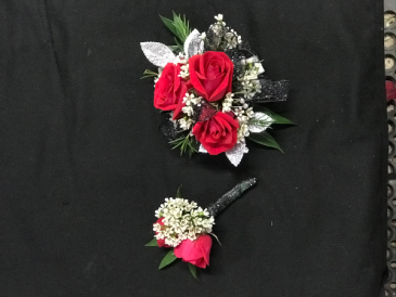 dark red boutonniere and corsage