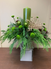 Deck The Halls Centerpiece with large pillar candle and fresh greens