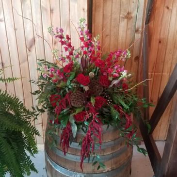 Deep Rich whiskey barrel arrangement Reception Florals