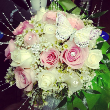 Delicate rose hand tided communion bouquet