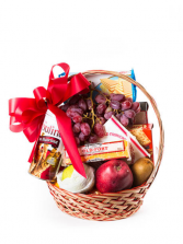 Deluxe Fruit Basket Fruit and candy basket in a wicker basket