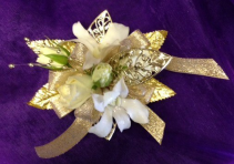 dendrobiums, spray roses and gold or silver leaf wrist corsage