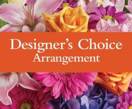 Designers choice floral arrangement  Vase