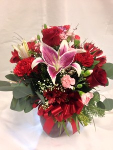 DLF Rose and Lily Sweetest Bouquet Classic Valentine colors and flowers in striking red vase.