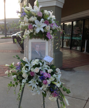 DOUBLE CROWN PICTURE FRAME MEMORIAL SPRAY  STANDING SPRAY W/2-CLUSTERS OF FLOWERS