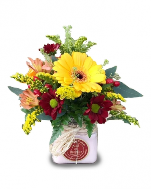 Double Time - flowers and a circle e candle  in Magnolia, TX | ANTIQUE ROSE FLORIST