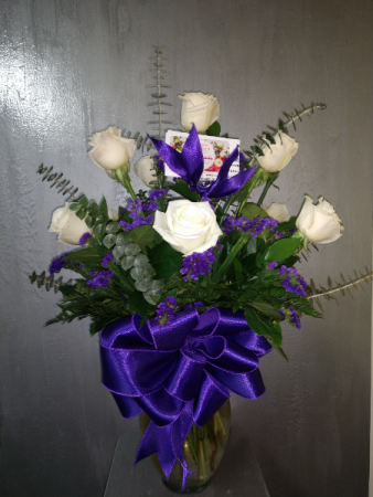 Dozen off white roses with purple accents