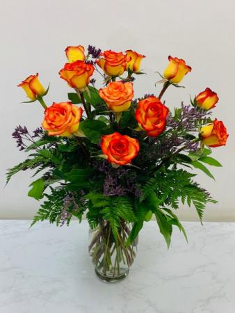 Dozen orange Roses vase