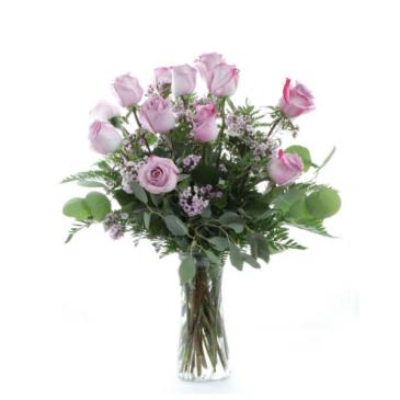 Dozen purple roses vase