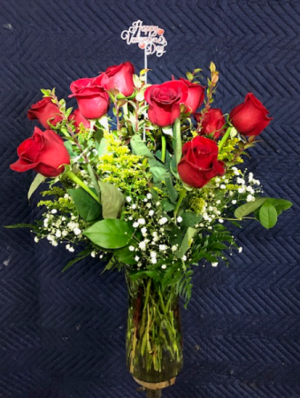 DOZEN RED ROSES W/ GREENS, BABYSBREATH & FILLERS VASE