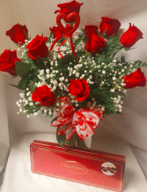 DOZEN RED ROSES WITH A BOX OF CHOCOLATES...12 RED ROSES ARRANGED IN A VASE WITH BABY'S BREATH AND HEART PIC AND A BOX OF CHOCOLATES!