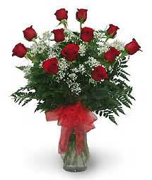 Dozen Red Roses with Baby's Breath and lush greens