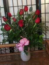 Dozen Roses in a premium colored vase  Roses