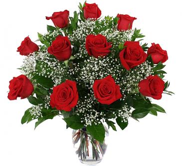 dozen roses in a vase