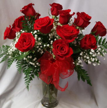 Dozen Red Roses arranged in a vase with  baby's breath and ribbon!