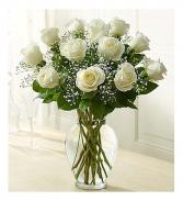 dozen white roses in vase