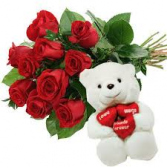 Dozen wrapped roses with love you teddy bear wrapped arrangement