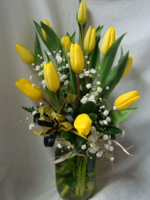 Black and Gold colors! Yellow tulips arranged  in a cute mason jar with baby's breath and a black and gold ribbon to send to your daughter for initiation!
