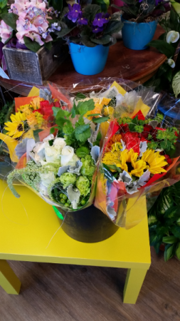 Ecuadorian Wrapped 30-Stem Bouquet Hand-wrapped bouquet in colored fabric. All bouquets vary in flowers and colors.