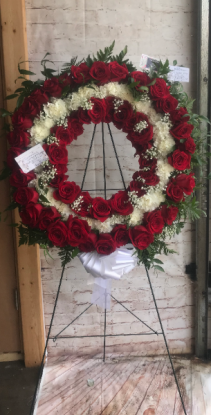 Elaborate red rose and white rose rememberance wre wreath