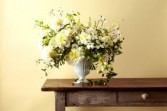 Elegance in Bloom Mixed Blooms in White Urn