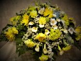 Elegance in shades of Yellows casket spray