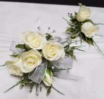 Elegant in white Wrist corsage and boutonniere