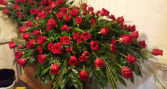 elegant red rose casket spray