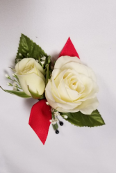 Elegant white with a touch of red Boutonniere