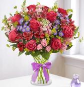 Enchanted Medley™ in a Clear Vase Arrangement