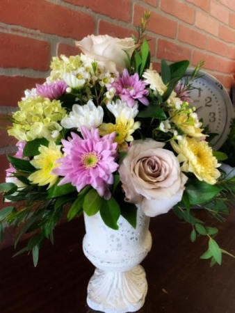 English Country Garden Gorgeous seasonal blooms arranged in a vintage-look compote container.