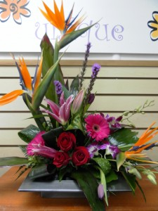 Winter flowers arrangement first class flowers ltd calgary ab exotic fragrance dish arrangement in calgary ab first class flowers ltd mightylinksfo