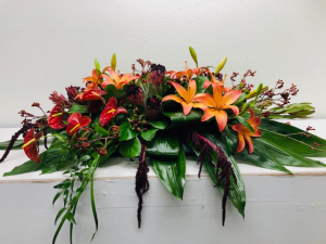 Exotic Tropical Casket Casket Arrangement in North Bend, OR | PETAL TO THE METAL FLOWERS