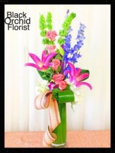 CHECK OUR CUSTOM PIECES ON FACEBOOK black orchid florist baytown
