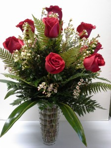 Exquisite Dozen Red Rose Arrangement In a Crystal vase