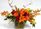 Fall in the Tropics Red & Orange roses, lilies and oncidium orchids and foliage