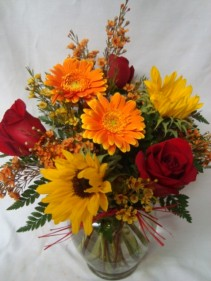 A Fall Favorite!! Roses, Gerbera daisies and  Sunflowers arranged with filler!