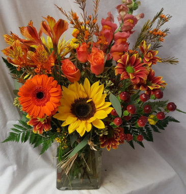 """Fall Blooms"" fall flowers arranged in glass Vase"